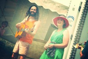 Kiri and Joe singing up a storm of gratitude at the final lunch time queue.