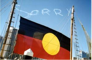 Image of aboriginal flag with sorry in the background