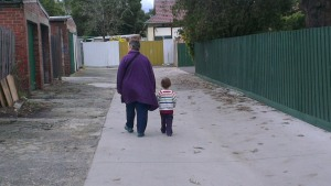 My son and my mother walking together.